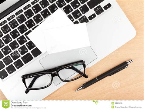 blank business cards  laptop  office table royalty