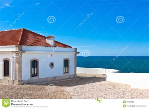 blue seas house turquoise sea blue sky and white house in portugal