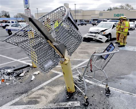 car crashes into car shopping cart and post in parking