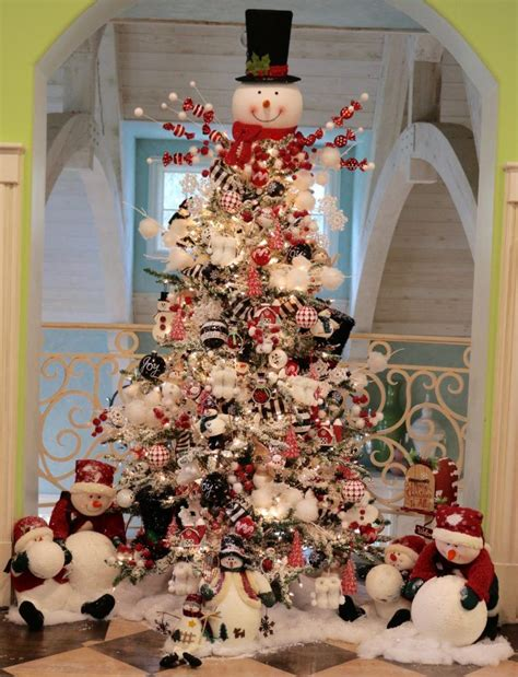christmas tree decorated with snowmen here is the snowman tree in our family room check out my for a tutorial on how