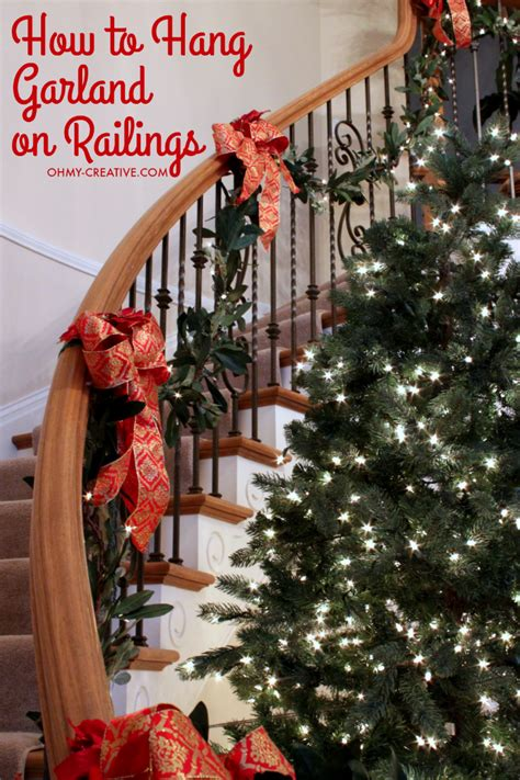 garland for stairs christmas how to hang garland on staircase banisters oh my creative