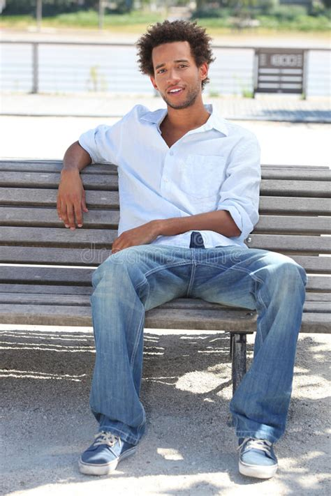 bench manly young man sitting on bench royalty free stock images