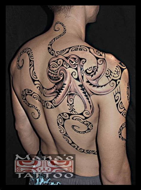 biggish polynesian octopus tattoo on back to arm 187 tattoo