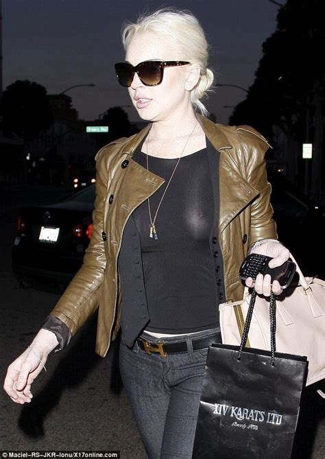 Lindsay Lohan Is Actually Wearing A Bra by Lindsay Lohan Steps Out Braless In A See Through Top