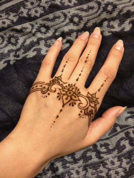 unique tattoo on hand unique hand henna tattoos egodesigns ink pinterest