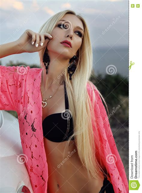 sexy woman blond hair stock photography image 10097442 woman with blond hair posing beside luxurious auto stock