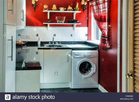 washing machine with sink washing machine and sink in a utility room of a house