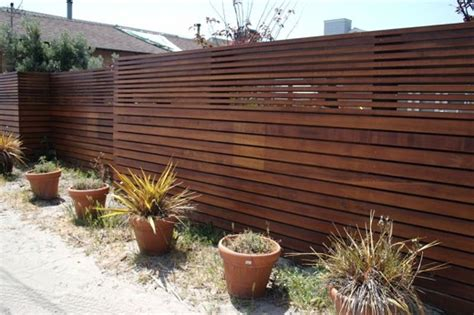 modern backyard fence wooden fence designs offer a rustic look design blog