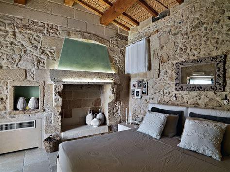 Antebellum Home Interiors by Rustic Bedroom Fireplace Mirror Relais Masseria Capasa