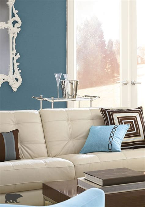 expert design tip opt for neutral furniture and bold wall colors in your living room to create