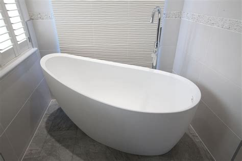 modern contemporary white freestanding free standing modern bathroom with white freestanding stone tub and