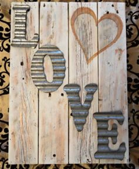 idea for wood metal mix decorations diy rustic love sign also a potluck sign made