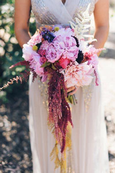 unique white  blush wedding bouquet inspiration   roses