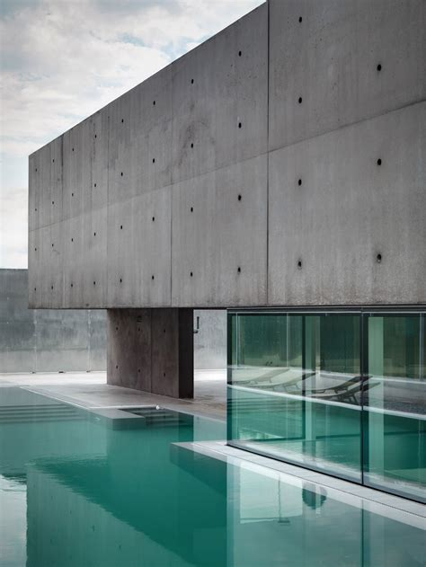exposed concrete walls glass walls exposed concrete concrete and glass home in urgnano italy