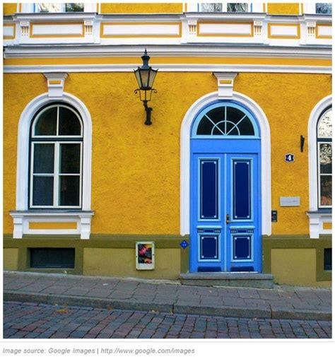 blue doors mustard yellow house   house exterior