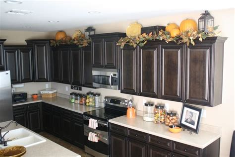 what to put on top of kitchen cabinets an idea to decorate on top kitchen cabinets for fall