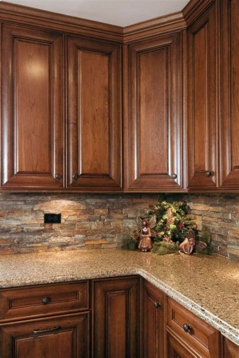 pictures of kitchens with backsplash like the cabinet style and backsplash tradition