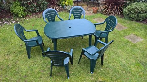 plastic outdoor table and chairs garden table chairs and parasol set green plastic in