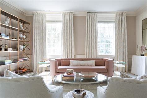 gold and pink living room with brass etagere