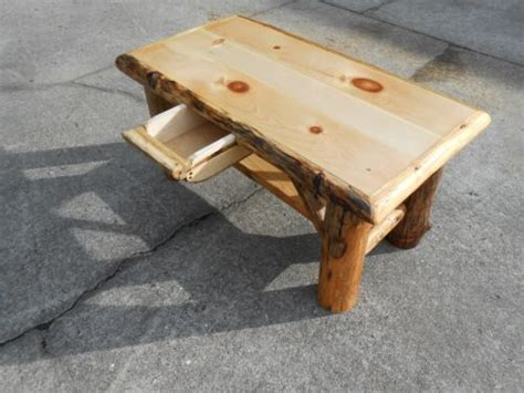 rustic log handcrafted coffee table with hideaway drawer