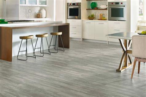 Waterproof flooring with hardwood and stone looks