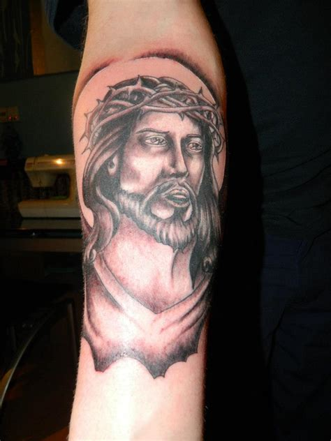 tattoo design jesus face black jesus face in cross tattoo stencil by hassified