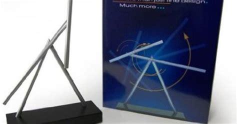 iron 2 swinging sticks kinetic energy sculpture