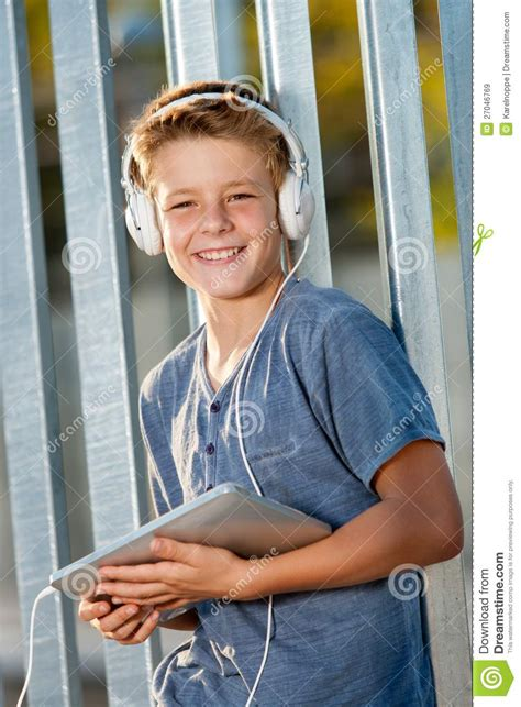 cute teen boy stock photos pictures royalty free cute cute teen boy holding tablet outdoors stock image image