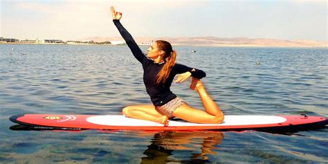 paddle boat yoga yoga stand up paddle boards by liquid shredder