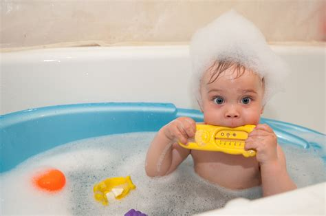 baby in a bathtub bathing a baby