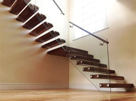 floating stairs floating walnut stairs with glass balustrade ajd bespoke