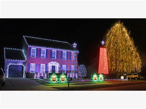 bel air christmas light display features towering addition