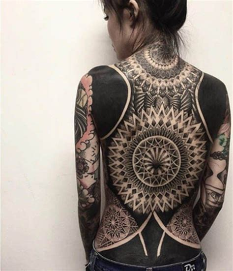 oracle tattoo in singapore tribal back tattoo with solid black sectionschester of