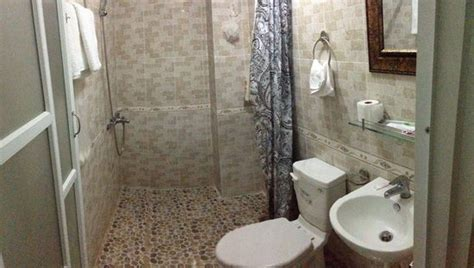 good size bathroom good size bathroom wet floor shower great pressure and