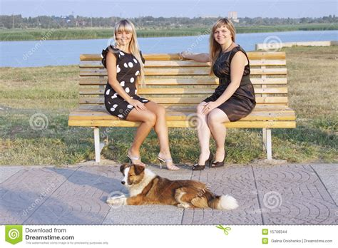 girls bench two girls in a park on a bench stock images image 15708344