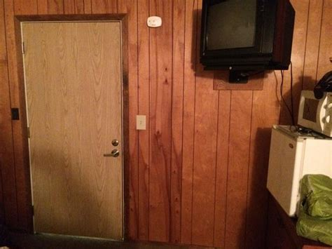 70 s style wood paneling a mismatched door and a tiny tv 70 s style wood paneling a mismatched door and a tiny tv
