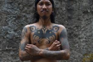 indonesian tattooists revive tribal traditions of hand