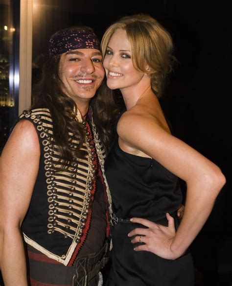 Galliano Gets Smoochy At Diors Cruise Show by Charlize Theron Photos Photos 2008 Cruise