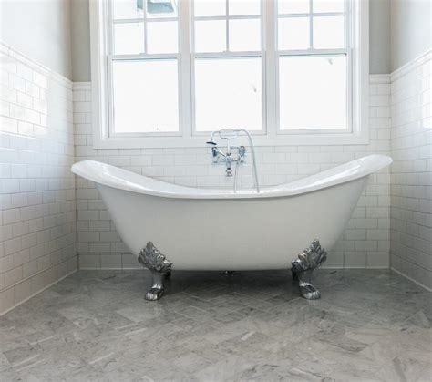 in floor bathtub silver claw foot tub with gray marble herringbone tile