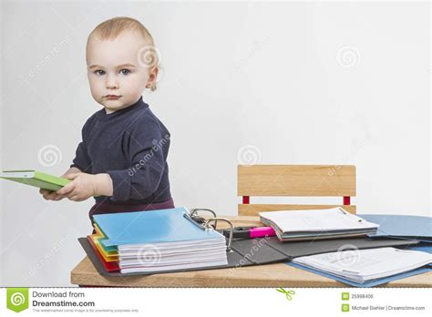 Kid At Desk by Child At Writing Desk Royalty Free Stock Image