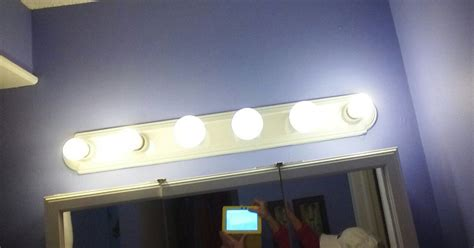 update hollywood bathroom lights what to do to update a six bulb vanity light hometalk