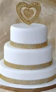 Indian Home Decor Blogs classy but simple gold and white wedding cake cake by