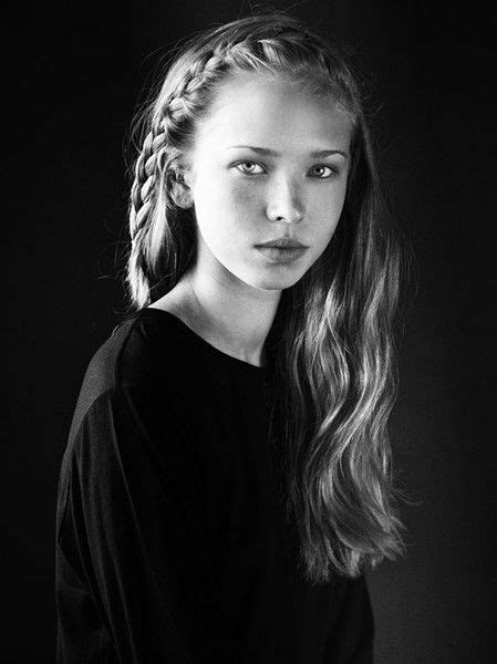 tween model grumpy black white photograph of young girl with braided hair