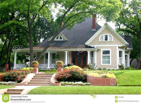classic house  flower garden stock photo image