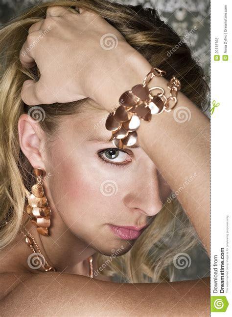 elegant mature woman wearing silver jewelry stock photo elegant woman and gold jewelry stock photography image