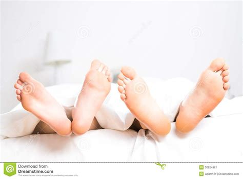 feet in bed couple feet in bed stock image image 30924981