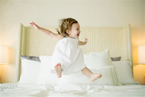 babies jumping on the bed inspirational child photographs from various photographers