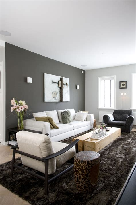 dark grey walls living room dark grey wall light grey couch shiny