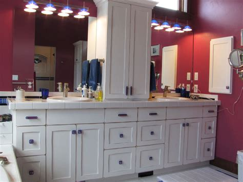white bathroom vanity with uneek glass cabinet hardware