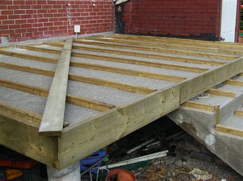 Installing Wood Deck Concrete Patio by Building A Wooden Deck A Concrete One 6 Steps With